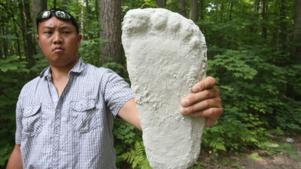 TORONTO, ON - JULY 12: Christopher Lau is one of Toronto's only active, authorized researcher registered with the international Bigfoot Field Researchers Organization. He holds up a plaster cast of alleged Bigfoot track from Patterson Grimlin's footage in 1967 .He poses for pictures in Eldred King Woodlands.        (Vince Talotta/Toronto Star via Getty Images)